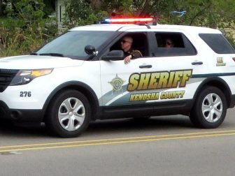 Kenosha County Sheriff SUV driving down street