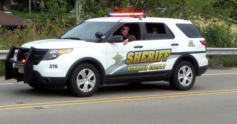Kenosha County Sheriff SUV driving down street