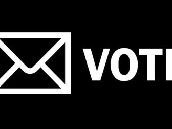 Black & White Mail Envelope and the word VOTE