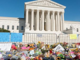 Flowers left as a memorial to Ruth Bader Ginsburg in front of SCOTUS