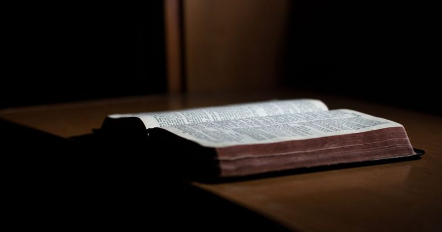 Close-up of paper black leather Bible