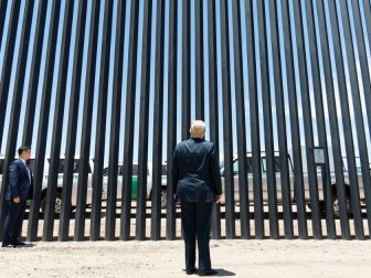 President Donald J. Trump stands before a plaque Tuesday, June 23, 2020, commemorating the 200th mile of new border wall along the U.S.-Mexico border near Yuma, Ariz. (Official White House Photo by Shealah Craighead)