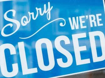 Blue closed sign on a glass window