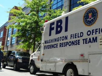 WASHINGTON (Sept. 18, 2013) An F.B.I. evidence response team collects evidence at Building 197 at the Washington Navy Yard. A gunman killed 12 people at the base Sept. 16, 2013.