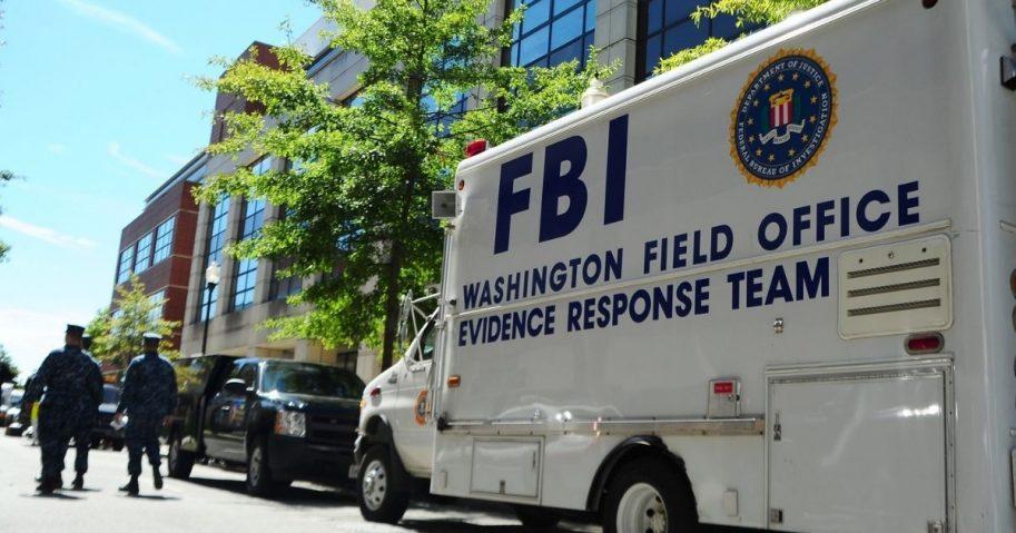 WASHINGTON (Sept. 18, 2013) An F.B.I. evidence response team collects evidence at Building 197 at the Washington Navy Yard. A gunman killed 12 people at the base Sept. 16, 2013.