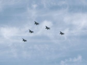 Five fighter jets in flight