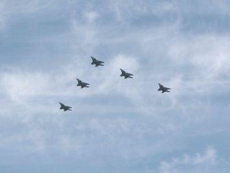 Five fighter jets in flight