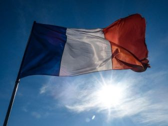 French flag flying on a sunny day