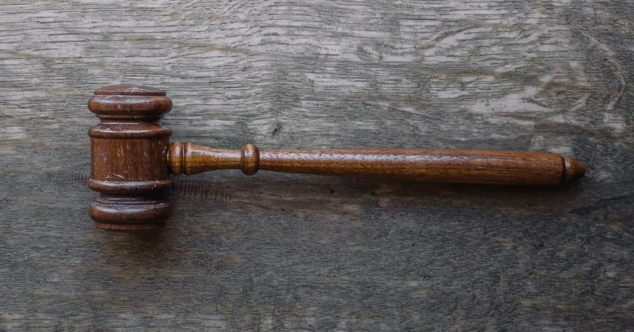 Brown gavel on a wooden table
