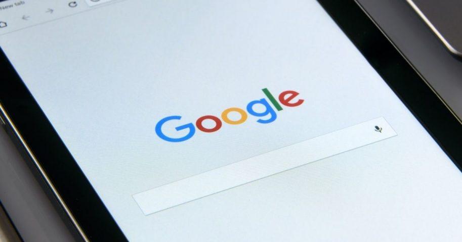 Black Samsung Tablet displays Google browser on screen.