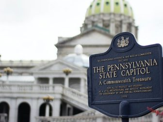 Pennsylvania State Capitol signage wtih capitol building in background