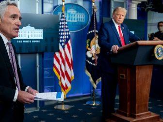 President Donald J. Trump listens to White House medical advisor Dr. Scott Atlas