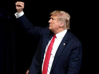 """President of the United States Donald Trump speaking with supporters at a """"Keep America Great"""" rally at Arizona Veterans Memorial Coliseum in Phoenix, Arizona."""
