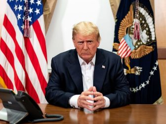President Donald J. Trump, joined by Chief of Staff Mark Meadows, participates in a phone call with Vice President Mike Pence, Secretary of Defense Mark Esper, Secretary of State Mike Pompeo, Chairman of the Joint Chiefs of Staff Gen. Mark Milley and National Security Advisor Robert O'Brien Sunday, Oct. 4, 2020, in his conference room at Walter Reed National Military Medical Center in Bethesda, Md. (Official White House Photo by Tia Dufour)