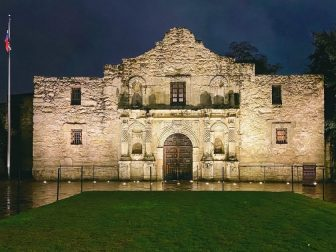 The Alamo in San Antonio, TX, lit up at night.