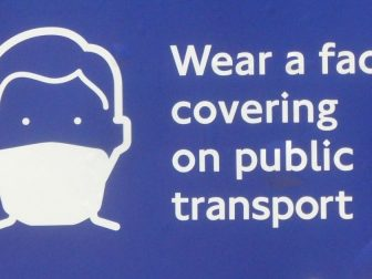 Wear a face covering on public transport sign