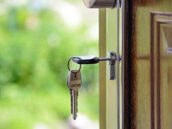 Black handled key in a front door