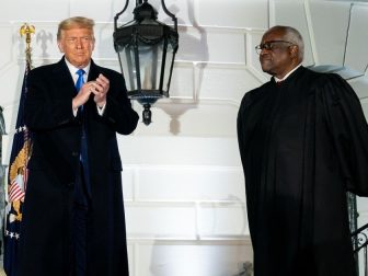 President Donald J. Trump, joined by associate U.S. Supreme Court Justice Clarence Thomas, applauds Amy Coney Barrett following her swearing-in as Associate Justice of the U.S. Supreme Court Monday, Oct. 26, 2020, on the South Lawn of the White House. (Official White House photo by Tia Dufour)