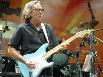 Eric Clapton playing a blue guitar