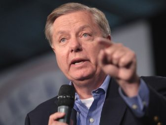 U.S. Senator Lindsey Graham speaking with attendees at the 2015 Iowa Growth & Opportunity Party at the Varied Industries Building at the Iowa State Fairgrounds in Des Moines, Iowa.