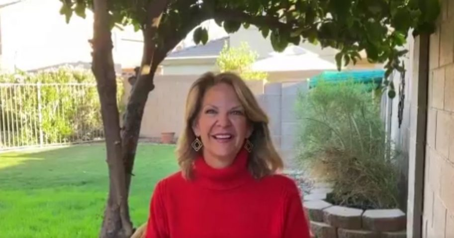 Arizona Republican Party chair Kelli Ward encourages supporters of President Donald Trump on Monday.