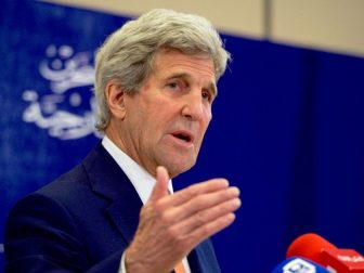 U.S. Secretary of State John Kerry addresses reporters during a joint news conference with Bahraini Foreign Minister Sheikh Khalid bin Ahmed al-Khalifa following a bilateral meeting on April 7, 2016, at the Four Seasons Hotel in Manama, Bahrain.