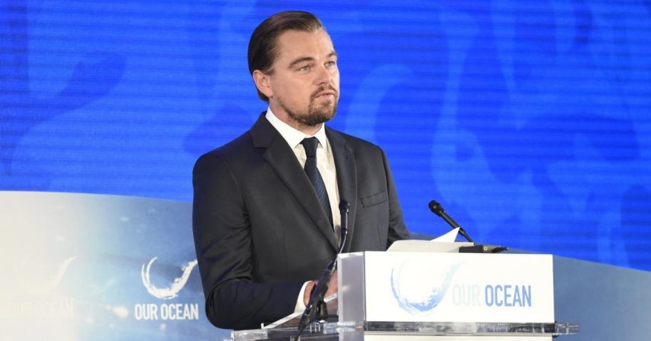 U.S. Secretary of State John Kerry watches actor and environmentalist Leonardo DiCaprio on September 15, 2016, as he addressed the third Our Ocean Conference at the U.S. Department of State in Washington, D.C.