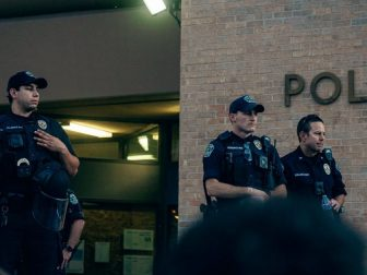 Image of police officers standing outside a police station.