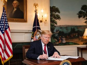 President Trump signing paperwork in the WH