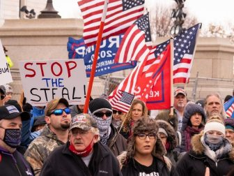 "On a day that saw Minnesota break a record high of 8,703 COVID cases, far-right conspiracy theorists Qanon and ""Stop The Steal"" followers stood maskless shoulder to shoulder outside the Minnesota State Capitol. Speakers led the crowd in bizarre covid/election chants."