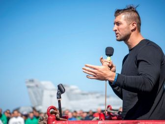 Tim Tebow addresses Sailors on the flight deck of Nimitz-class aircraft carrier USS Carl Vinson (CVN 70) during a visit to the ship. (U.S. Navy photo by Mass Communication Specialist 3rd Class Michele Fink/Released)