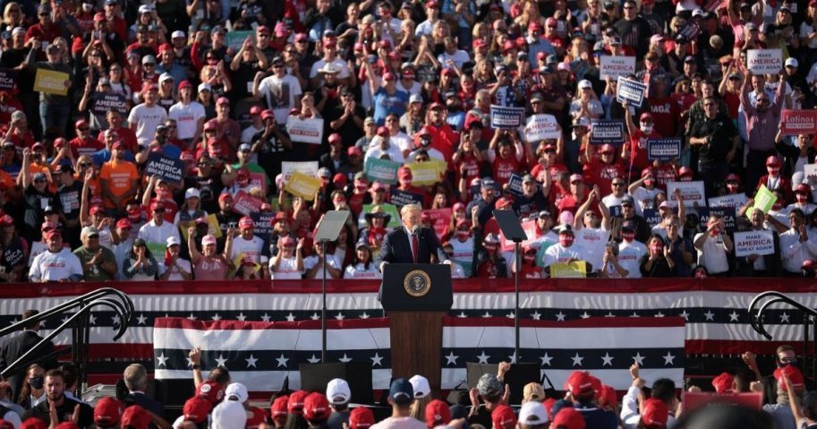 """President of the United States Donald Trump speaking with supporters at a """"Make America Great Again"""" campaign rally at Phoenix Goodyear Airport in Goodyear, Arizona."""