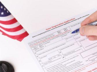 Man filling out Voter Registration Application