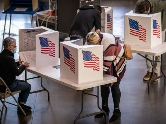 Voters in Des Moines precincts 43, 61 and 62 cast their ballots at Roosevelt High School.