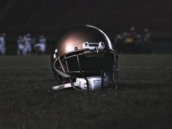 Football helmet on a grass field