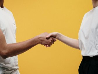 People making handshake as a sign of success