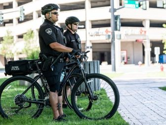 Boise police on bikes in front of parking structure