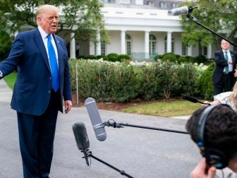 President Donald J. Trump talks to members of the press along the South Lawn driveway Thursday, Sept. 24, 2020, prior to boarding Marine One en route to Joint Base Andrews, Md. to begin his trip to North Carolina and Florida. (Official White House Photo by Tia Dufour)