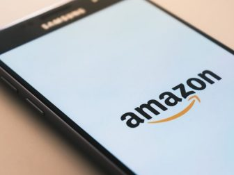 Black smartphone displaying Amazon logo