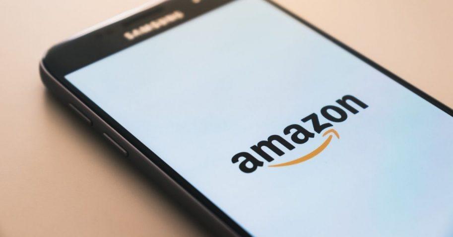 Black smartphone displaying Amazon logo
