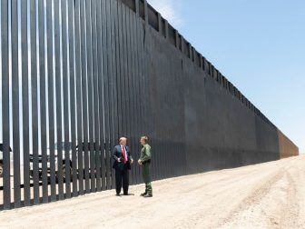 President Donald J. Trump meets U.S. Border Patrol Chief Rodney Scott as he walks along the completed 200th mile of new border wall Tuesday, June 23, 2020, along the U.S.-Mexico border near Yuma, Ariz. (Official White House Photo by Shealah Craighead)