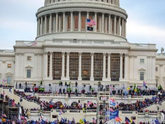 A large group of pro-Trump protesters stand on the East steps of the Capitol Building after storming its grounds on Jan. 6 in Washington, D.C.