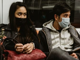A young couple in face masks riding the subway in Rome, Italy during the Covid-19 pandemic