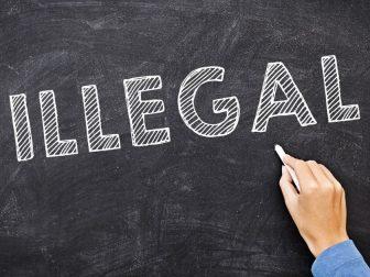 Illegal written on a chalk board