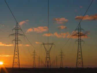Power pylons at sunset