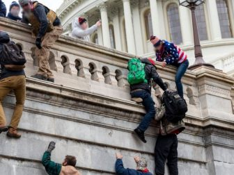 Protesters scaling wall at Capitol