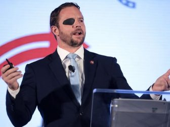 U.S. Congressman Dan Crenshaw speaking with attendees at the 2019 Teen Student Action Summit hosted by Turning Point USA at the Marriott Marquis in Washington, D.C.