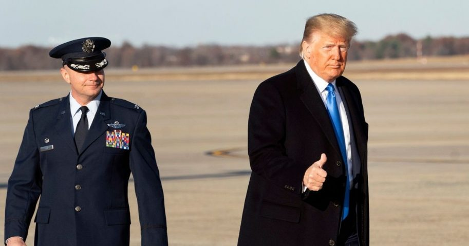 Former President Donald Trump gives a thumbs up prior to boarding Air Force One at Joint Base Andrews, Maryland, on Dec. 7, 2019.