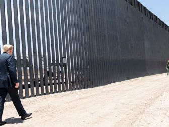 President Donald J. Trump walks along the completed 200th mile of new border wall Tuesday, June 23, 2020, along the U.S.-Mexico border near Yuma, Ariz. (Official White House Photo by Shealah Craighead)
