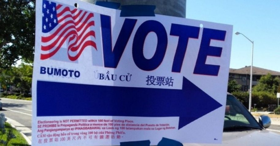 A vote sign is seen above.